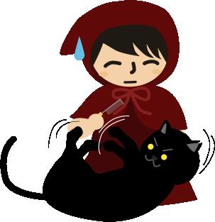 櫛にじゃれつく黒猫