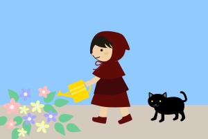 庭で花に水をやる