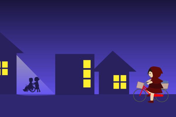 夜道で車椅子のご夫婦を見守る