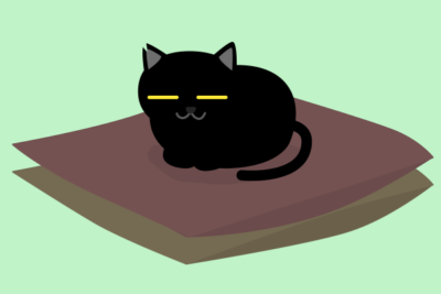 座布団に座る黒猫