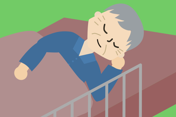施設のベッドで寝る父
